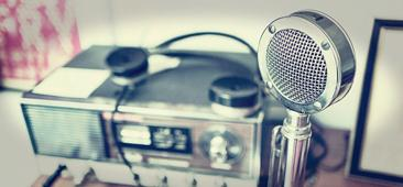 Picture of an antique radio broadcasting unit with old time microphone