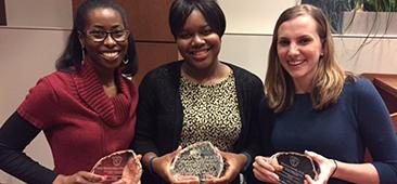 Picture of three professionals displaying their awards for Academic Medical Excellence