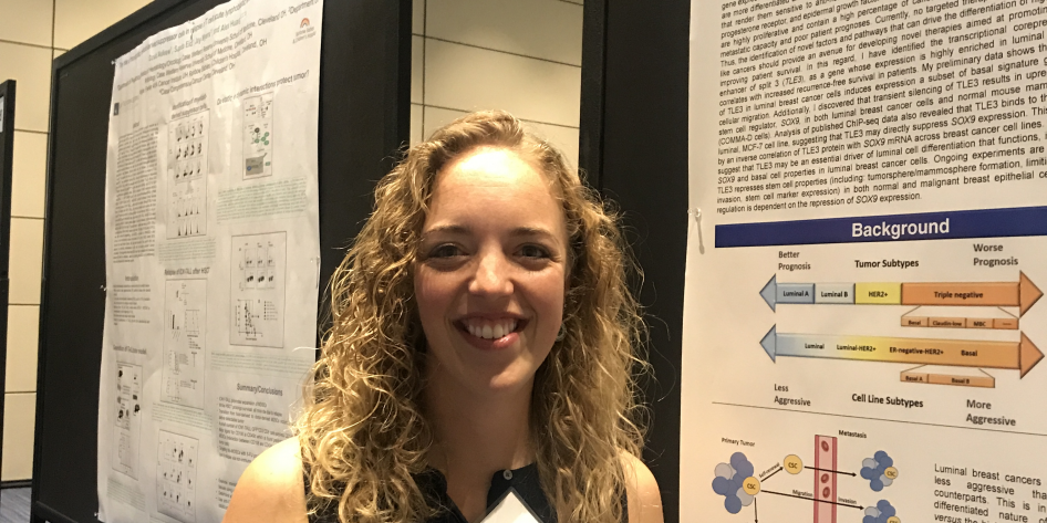 Lindsey with her poster at Cancer Center Retreat 2018