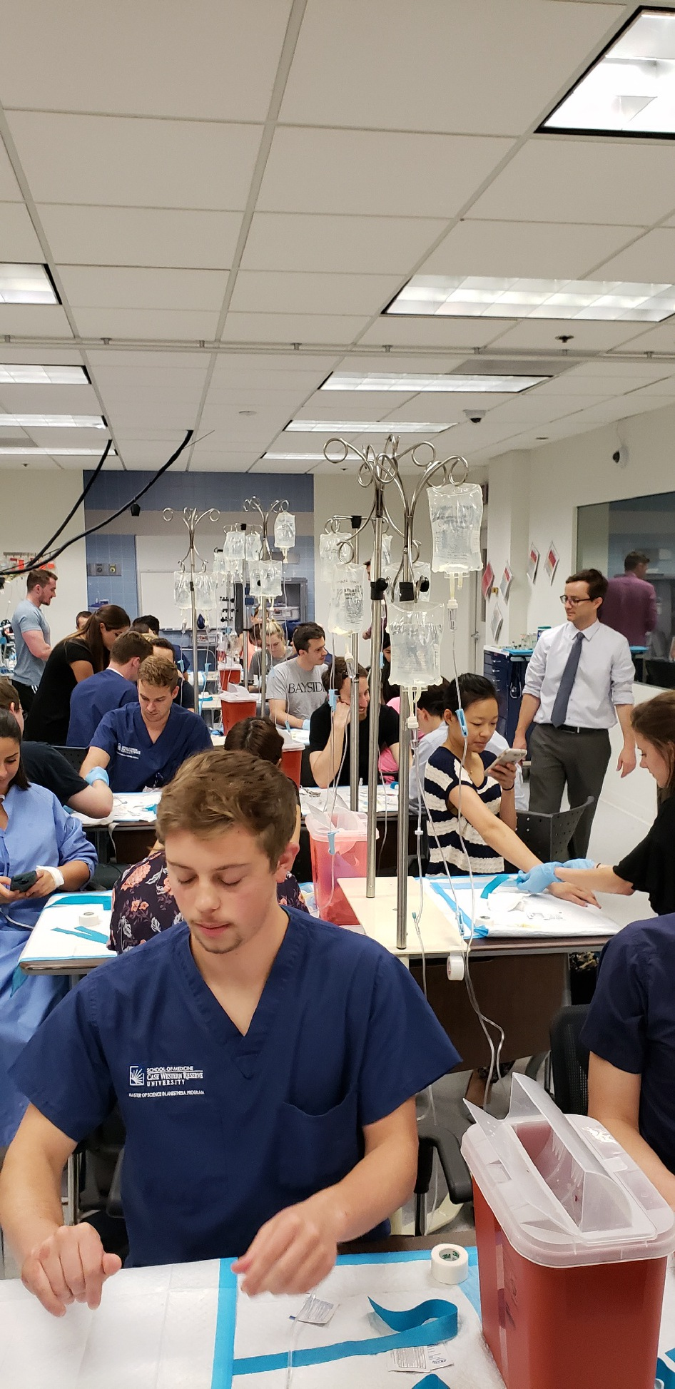 Group of CWRU Master of Science in Anesthesia students practice IVs