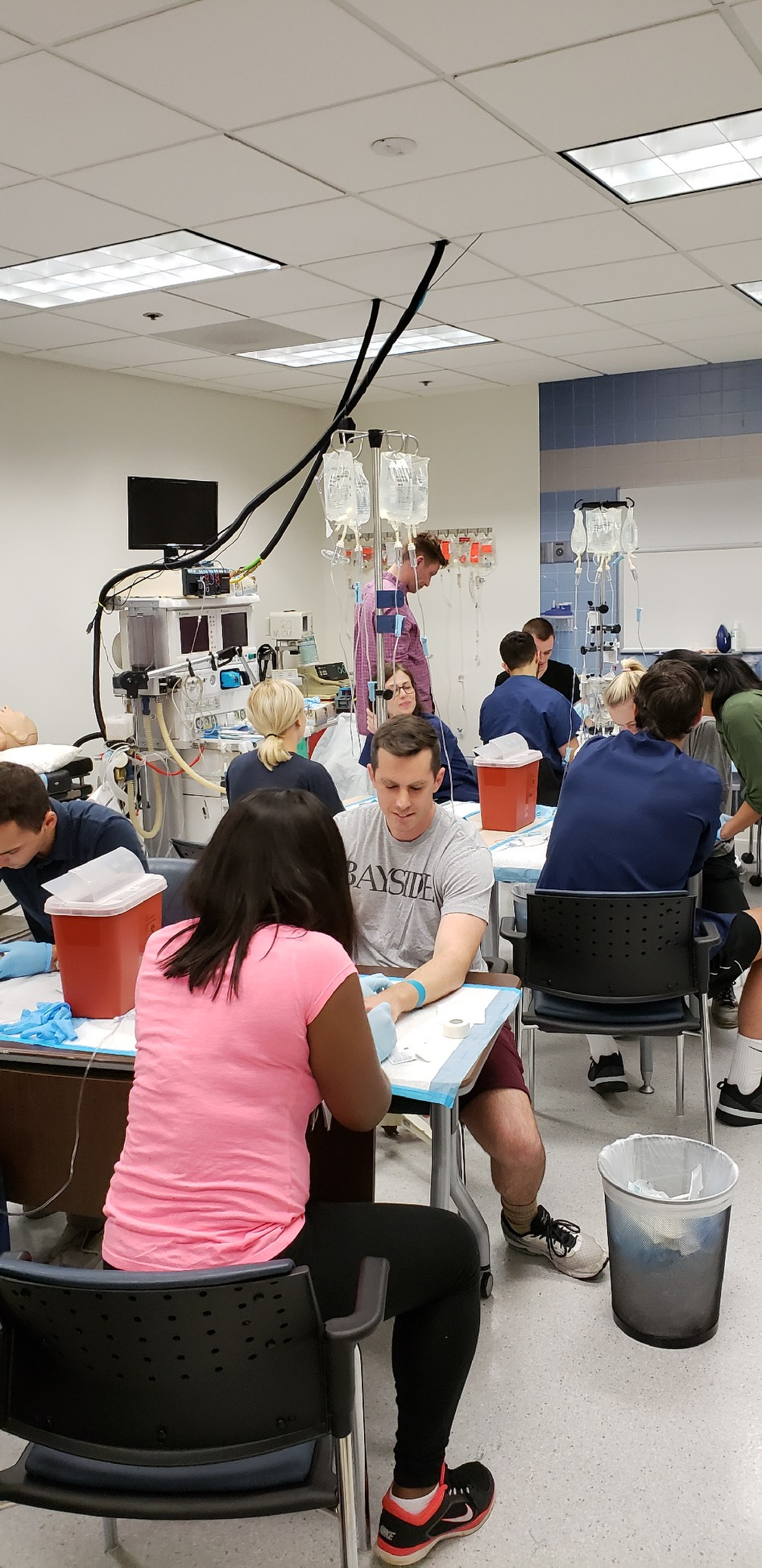 Group of CWRU Master of Science in Anesthesia students practice IVs in DC classroom