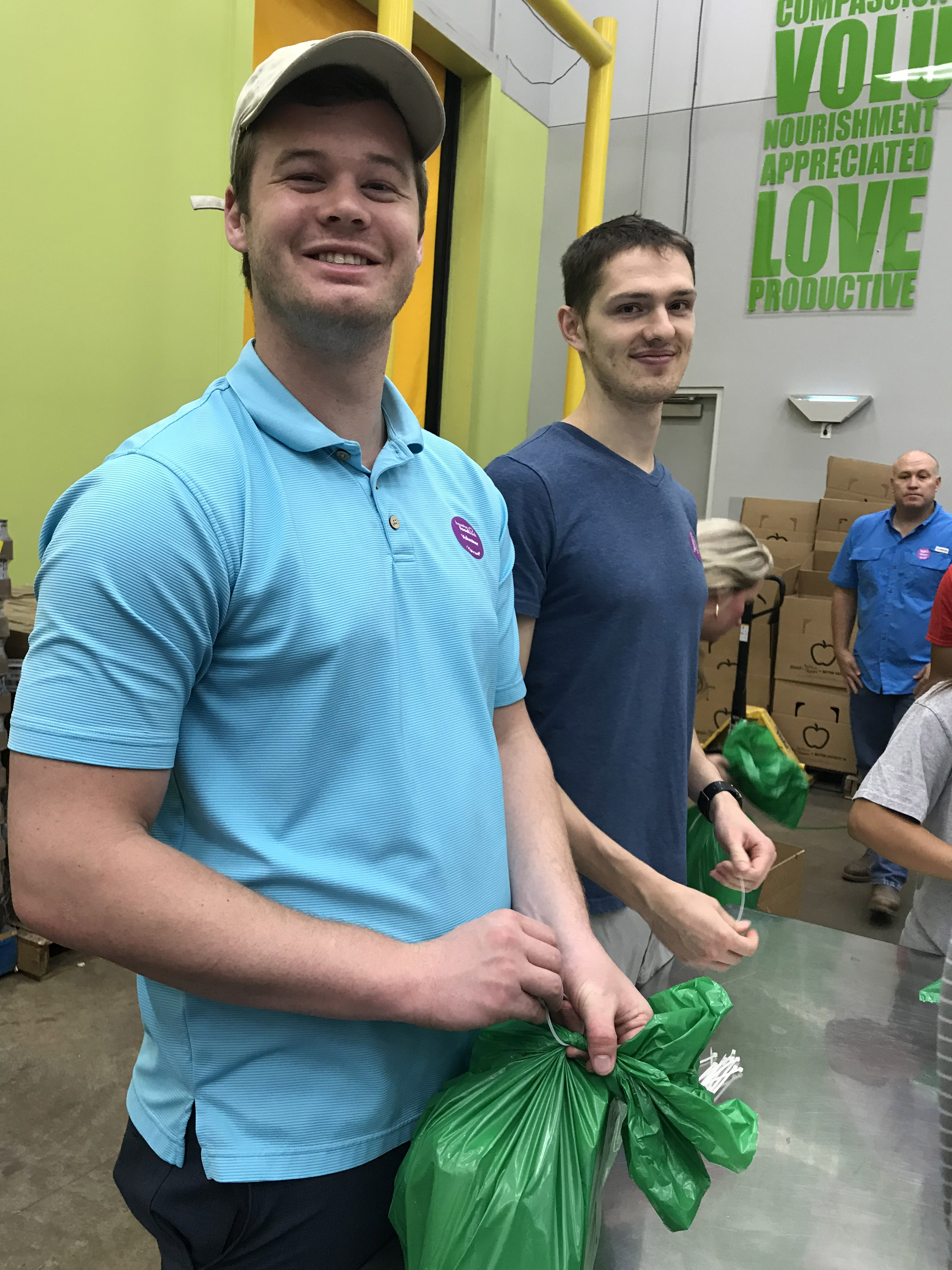 Two CWRU MSA Houston students at the Houston Food Bank