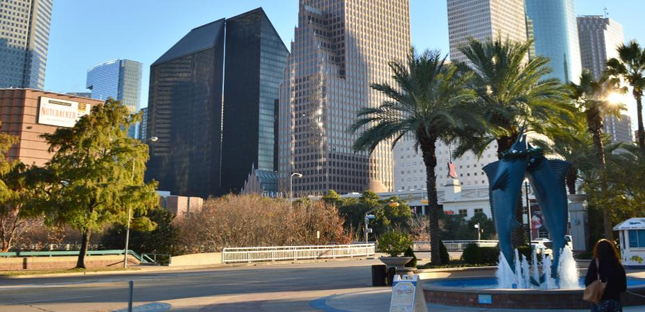 Image of daytime Downtown Houston Texas USA streetview with buildings in background and fountain in foreground