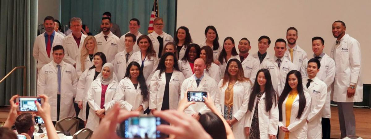 Anesthesiologist assistant students in white coats at CWRU Houston, Texas