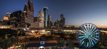 Image of nighttime skyline of Houston Texas USA with lit ferris wheel in the foreground
