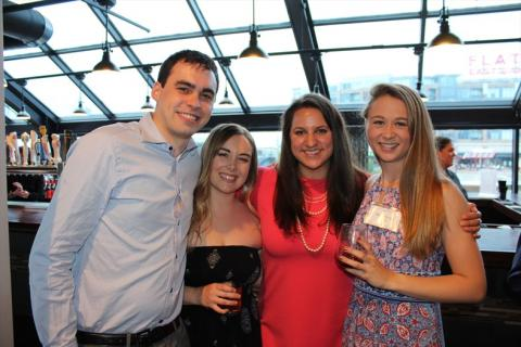 Four Master of Science in Anesthesia students posing together at event
