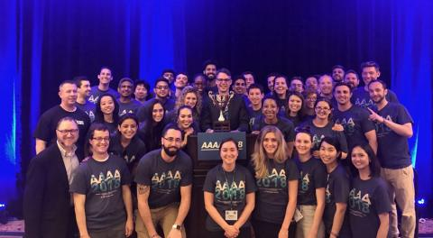 Group of Master of Science in Anesthesia Program students with trophy at AAAA conference