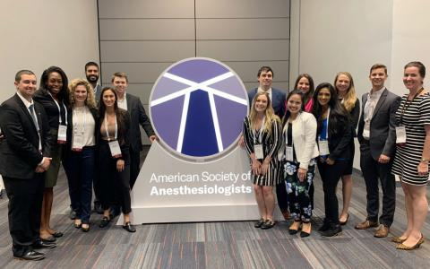 Case Western Reserve University Master of Science in Anesthesia students with sign reading American Society of Anesthesiology