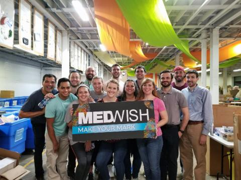 Group of Master of Science in Anesthesia students holding MedWish Make Your Mark sign