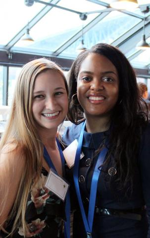 Two female certified anesthesiologist assistant program graduates at event