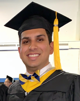 Male anesthesiologist assistant student in graduation robes