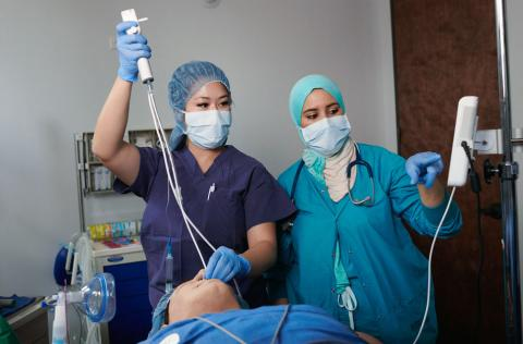 Two female anesthesiologist assistants in simulation lab