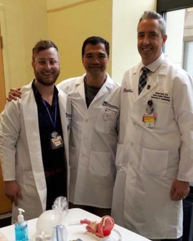 Three male anesthesiologist assistants wearing white coats