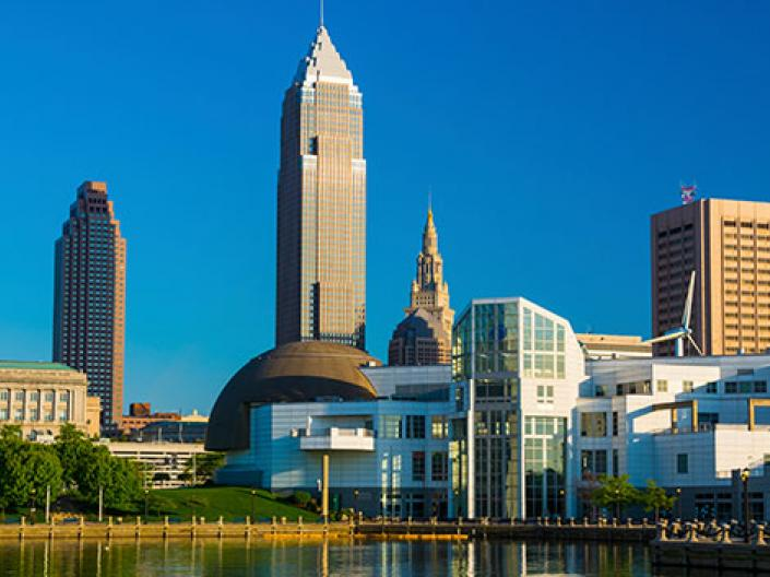 A picture of downtown Cleveland with Lake Erie in front