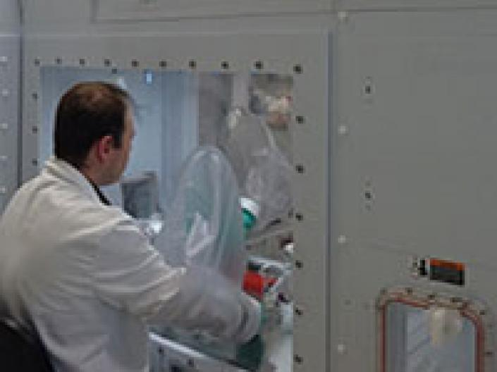 Male researcher working on a machine.