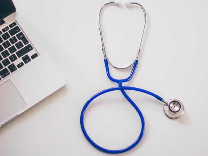 Photo of stethoscope and laptop