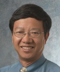 Image of Dr Lu with black hair and glasses
