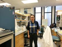 Lei Zhang in a lab room