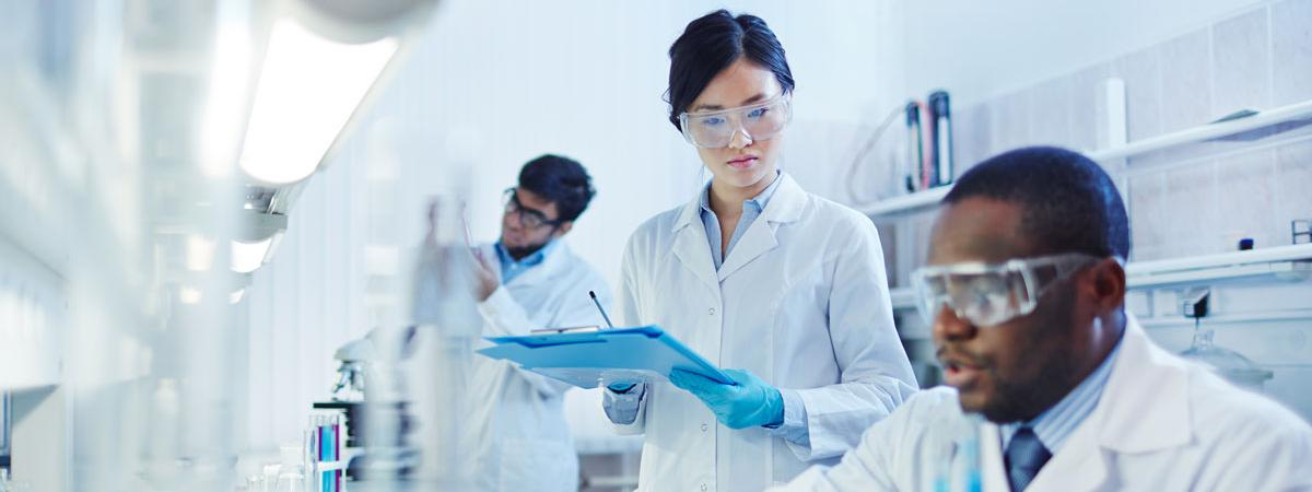 Close up of two people working in a lab