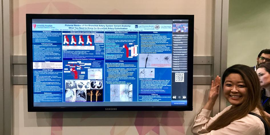 TV with electronic medical education poster with women (Lisa Walker) on the left pointing at the poster