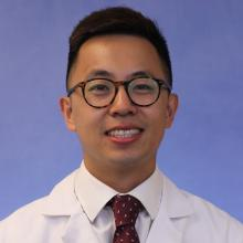 Headshot of medical student Jonathan Gan with light blue background