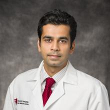 Headshot of Dr. Sidhartha Tavri, MD in doctor's white coat
