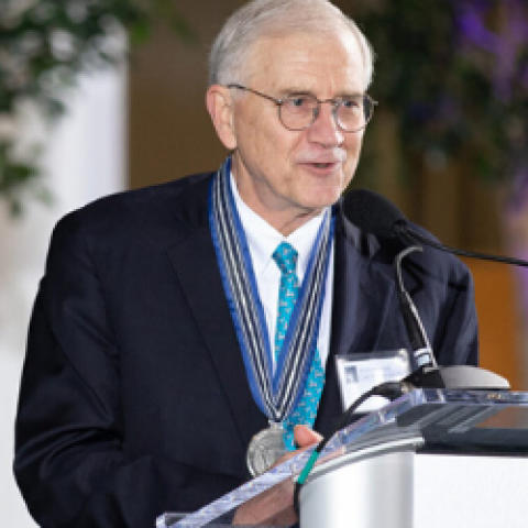 Photo of Dr. Jim Young speaking at a podium