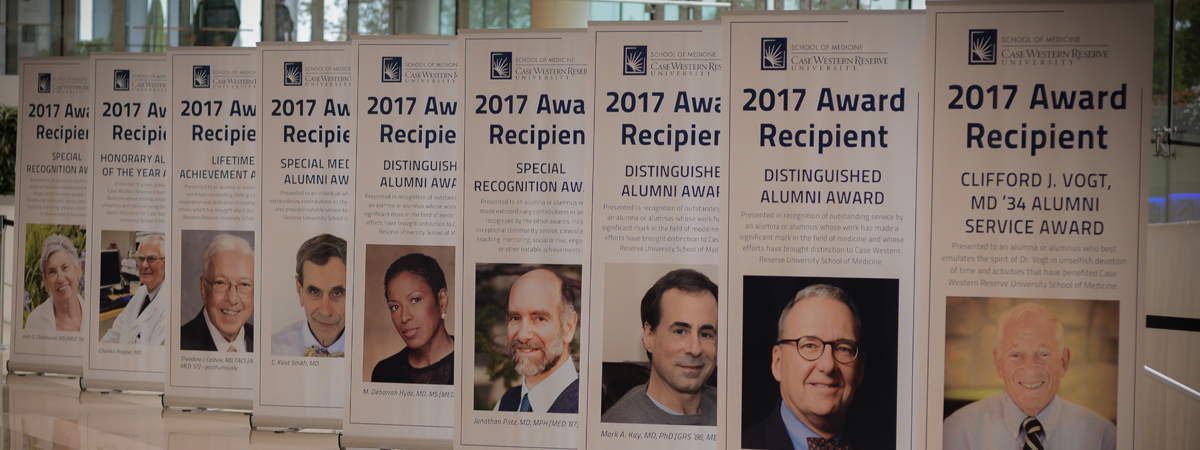 A group of 9 standing banners depicting the 2017 alumni award recipients at CWRU School of Medicine Reunion