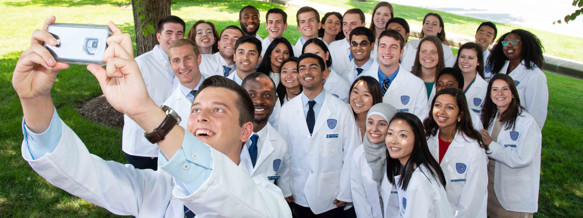 CWRU Medicine students take group selfie at the White Coat Ceremony