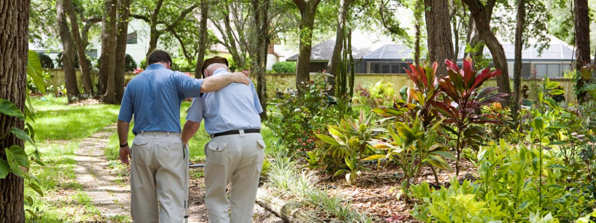 photo of caregiver and patient walking