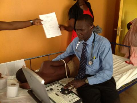 Emmy Okello treating patient