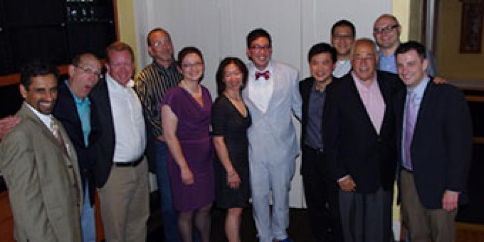 Dr. Nathaniel Liu Graduation, 2014 with twelve people in dress attire