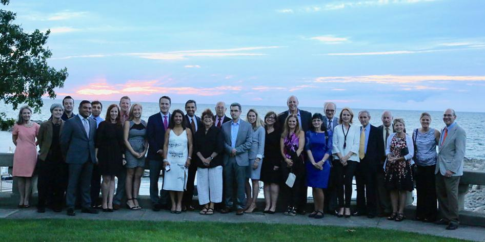 5th Annual Dr. Jerry Goldstone Endowed Lectureship Group 2017 Photo with 26 persons with Lake Erie sunset backdrop