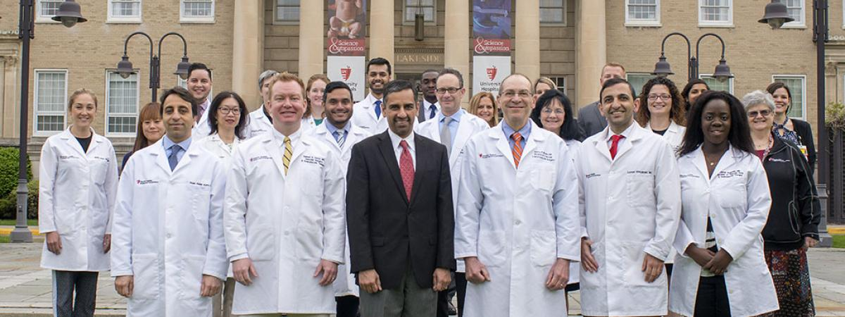 Vascular department photo 2018 outside front of the University Hospitals Cleveland Medical Center Lakeside building, with 24 persons, with 15 in white lab coats.