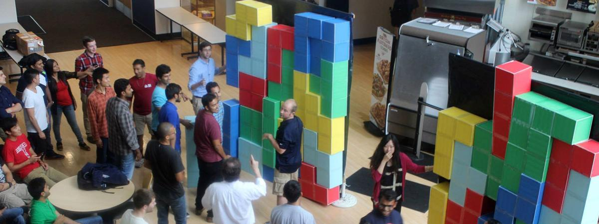 A group of students playing a life sized tetris