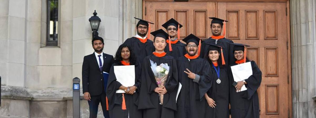 Students posing after graduating