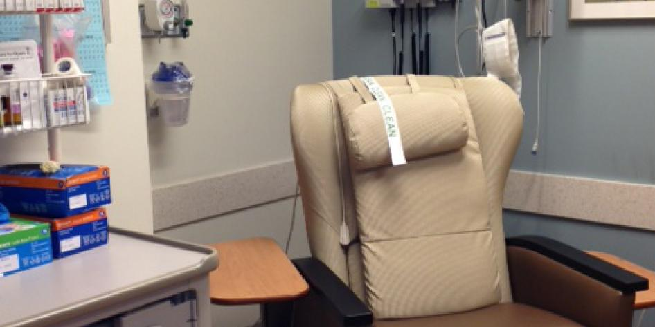 A large leather chair with cushion and a place for the patient's arm to rest during treatment
