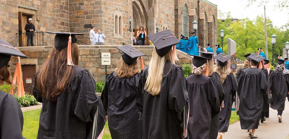 Nursing students at Case Western Reserve University wearing graduation robes and walking to their diploma ceremony.