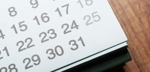 Photo of a calendar on a desk.