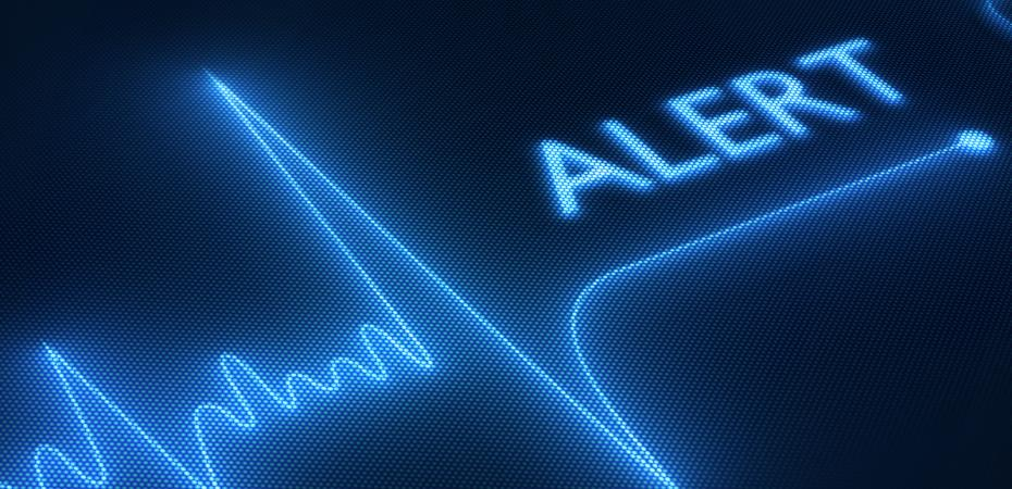 Stock image of an EKG test with an alert notification