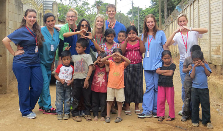 Picture of CWRU FPB students posting with young citizens of Guatemala.