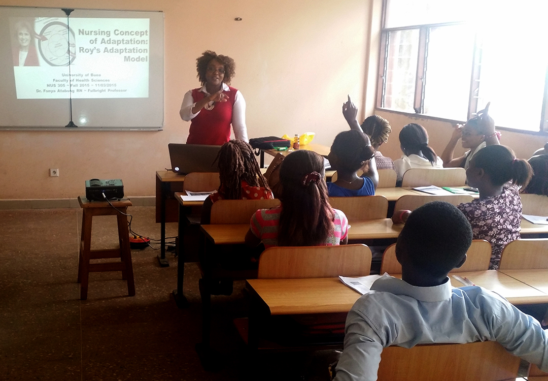 Fonya Atabong teaching in a classroom full of students