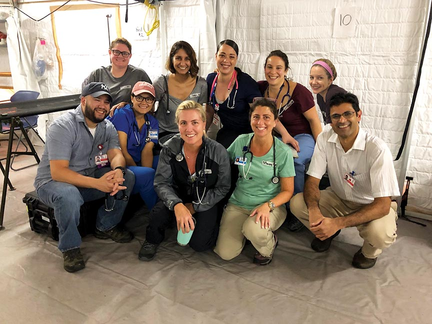 Team One medical volunteers in Fajardo, Puerto, Rico, front row, from left: Juan Baez, RN; Melanie Pratts, RN; Christine Mahoney, MS, RN; Stacey A. Conklin, MSN, MS, RN; and Kevin Munjal, MD; back row, from left: Colleen Fischer, RN; Karendip Kaur Braich, MD; Helen Rosario, RN; Emma Kaplan-Lewis, MD; and Erin Hogan, RN.