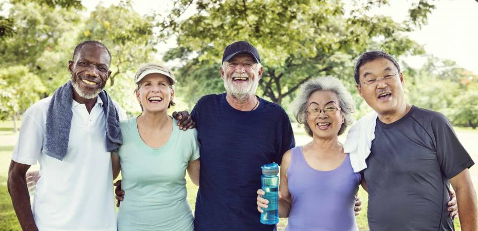 Stock image of older adults wearing athletic or work out clothing while outside.