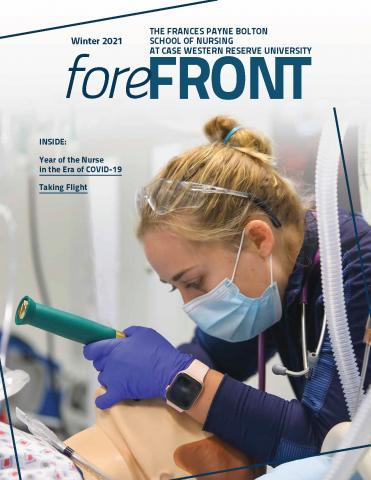 Cover of the Winter 2021 issue of Forefront magazine that features a student finding an airway on a mannikin.