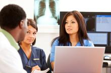 Stock photo of nurses discussing patient care.