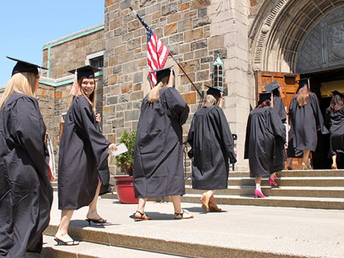 Photo of CWRU FPB nursing students walking into a building for commencement.