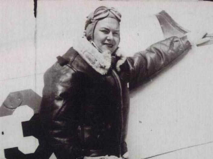 Picture of Dorothy Ebersbach standing next to a airplane.