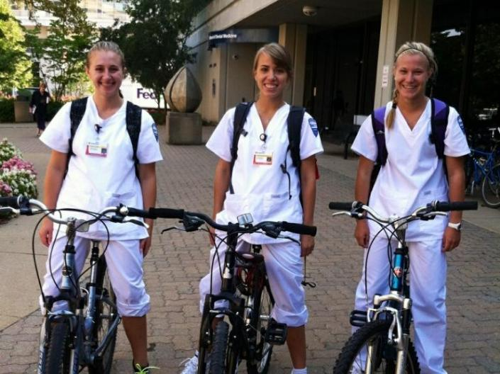 Students posing on their bikes before their first day of clinicals.