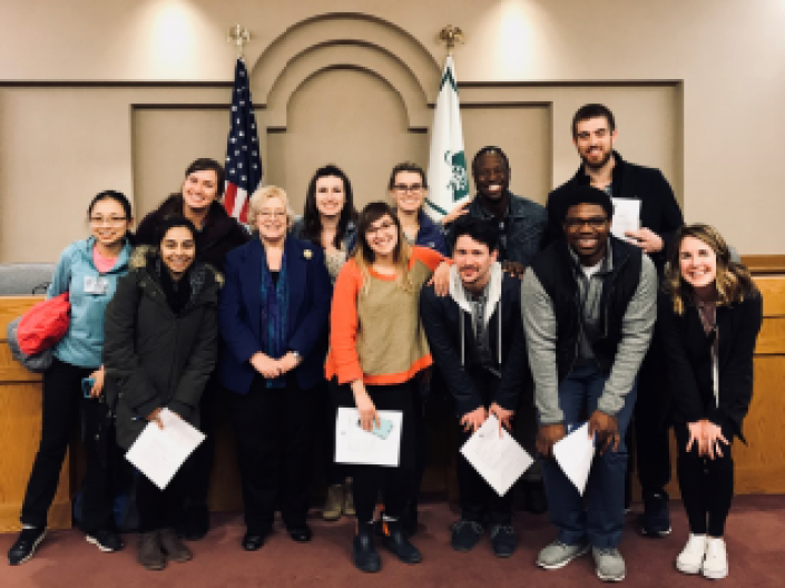 Health Policy students posing for a picture after a  Cleveland Heights City Council meeting